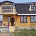 Сруб дома 5 на 5 метров с мансардой и ломаной крышей