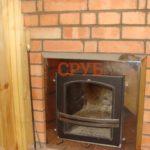 Печка в срубе бани вмонтированная в стену