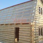 Реализованный сруб бани с ломанной крышей